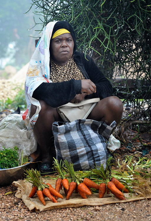 A woman sells onions in the market in Mizak, a small village in the south of Haiti.