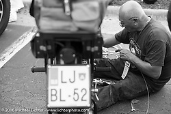 Sante Mazza works on his 1926 Moto Frera during Stage 2 of the Motorcycle Cannonball Cross-Country Endurance Run, which on this day ran from Lake City, FL to Columbus, GA., USA. Saturday, September 6, 2014.  Photography ©2014 Michael Lichter.