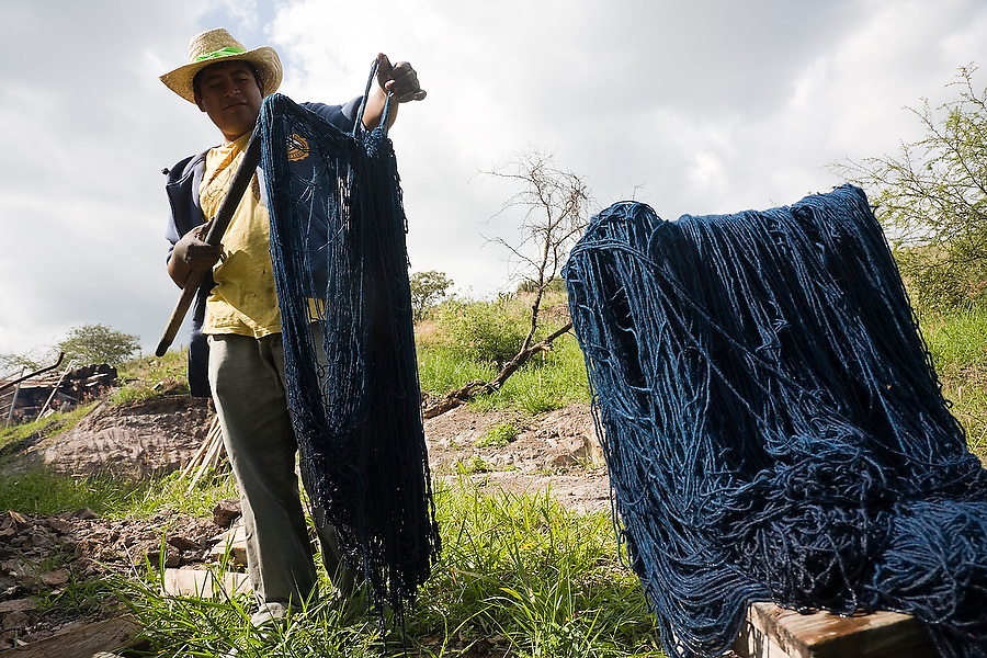 A man dries wool dyed dark blue with indigo in the famed Zapotec weaving village of Teotitlan del Valle, Oaxaca state, Mexico on July 27, 2008.