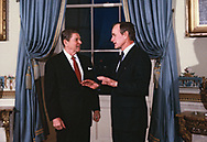 Preesident Reagan and Vice President H..W. Bush in the Blue Room of the White House in February 1984<br /><br />Photograph by Dennos Brack  bb77