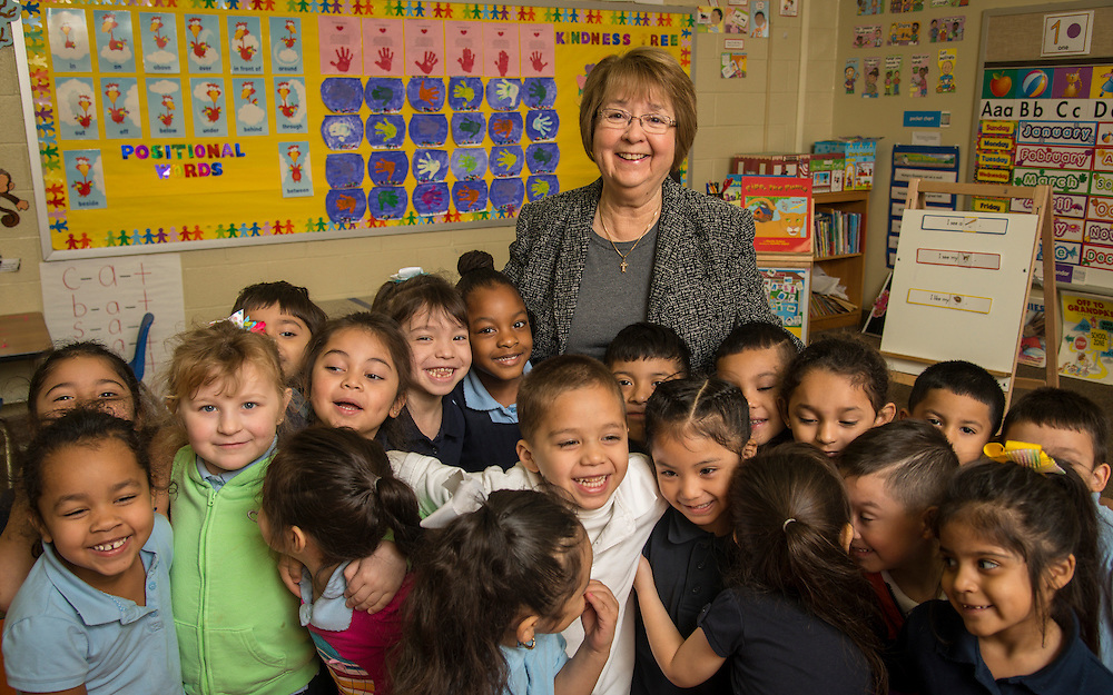 Herlinda Garcia poses for a photograph with Pre-K students at JP Henderson Elementary School, February 21, 2015.
