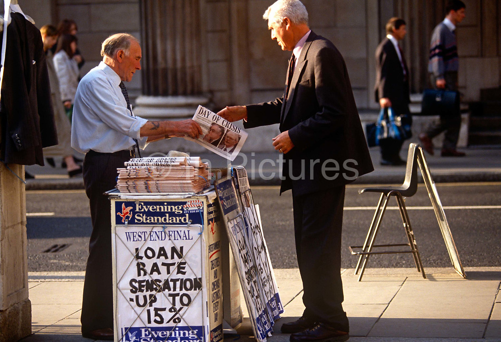 A city worker buys a copy of the Evening Standard with a headline relating to the ERM crisis in 1992, known as Black Wednesday which referred to the events of 16 September 1992 when the British Conservative government was forced to withdraw the pound sterling from the European Exchange Rate Mechanism (ERM) after they were unable to keep it above its agreed lower limit. George Soros, the most high profile of the currency market investors, made over US$1 billion profit by short selling sterling. In 1997 the UK Treasury estimated the cost of Black Wednesday at £3.4 billion, with the actual cost being £3.3 billion which was revealed in 2005 under the Freedom of Information Act