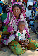 Woman sitting holding a child in Northern Nigeria