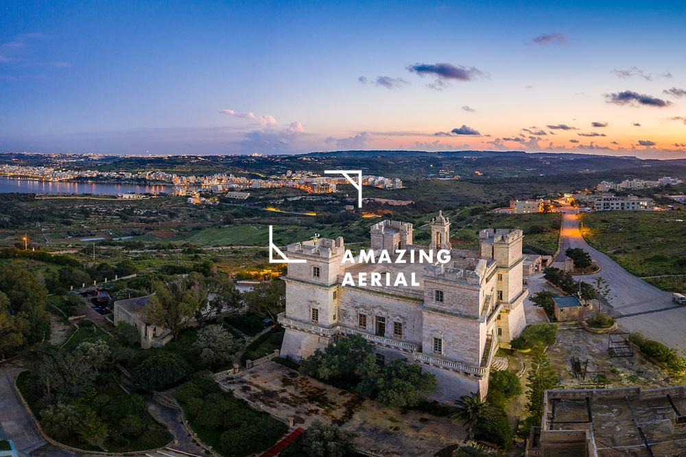 Aerial view of Verdala Palace in the limits of Rabat Malta at sunset