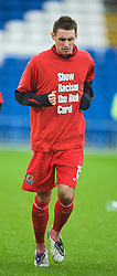 CARDIFF, WALES - Saturday, November 14, 2009: Wales' Andy Dorman warms-up wearing a 'Show Racism the Red Card' shirt before the international friendly match against Scotland at the Cardiff City Stadium. (Pic by David Rawcliffe/Propaganda)