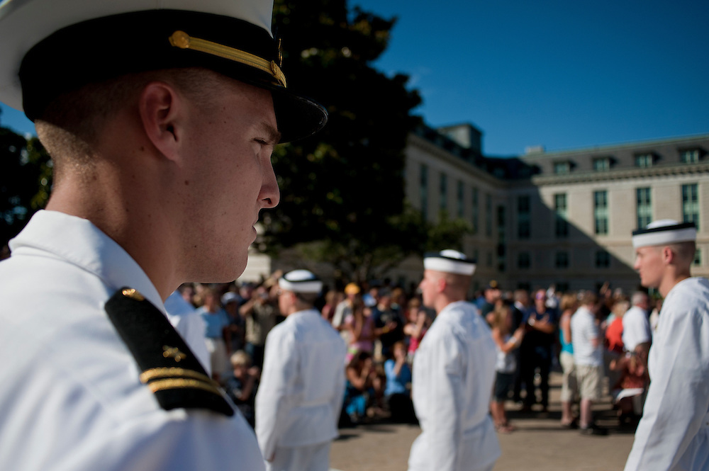 "An upper classman watches closely as the new mid-shipmen parade in front of family and friends shortly before taking the Midshipman Oath of Office.  Approximately 1,230 young men and women arrived at the U.S. Naval Academy's Alumni Hall, Thursday, July 1, for Induction Day to begin their new lives as ""plebes"" or midshipmen fourth class (freshmen). ""I-Day"" culminates when the members of the Class of 2014 take the oath of office at a ceremony at 6 p.m. in Tecumseh Court, the historic courtyard of the Bancroft Hall dormitory. Over 17,400 young men and women applied to be members of the Naval Academy Class of 2014 - a record for USNA."