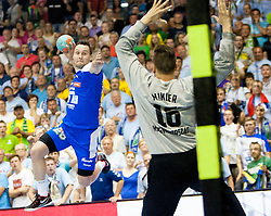 Luka Zvizej #20 of Slovenia and Roland Mikler #16 of Hungary during handball match between National teams of Slovenia and Hungary in play off of 2015 Men's World Championship Qualifications on June 15, 2014 in Rdeca dvorana, Velenje, Slovenia. Photo by Urban Urbanc / Sportida