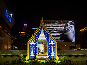 25 OCTOBER 2017 - BANGKOK, THAILAND: A shrine for the late king at a Bangkok shopping mall. People will bring sandalwood flowers to the shrine Thursday during the funeral for Bhumibol Adulyadej, the Late King of Thailand. He died in October 2016 and was cremated during an ornate five day funeral on 26 October 2017. He reigned for 70 years and was Thailand's longest serving monarch.         PHOTO BY JACK KURTZ