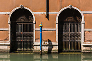Architectural details of a Venetian building and canal, Venice, Italy