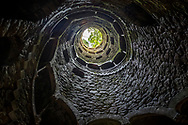 The 27 metre deep Masonic Initiation Well in Sintra, Portugal. The unfinished well is on the grounds of Quinta da Regaleira, a botanical garden of sorts filled with numerous follies designed by Luigi Manini for the eccentric landowner, Antonio Augusto Carvalho Monteiro.
