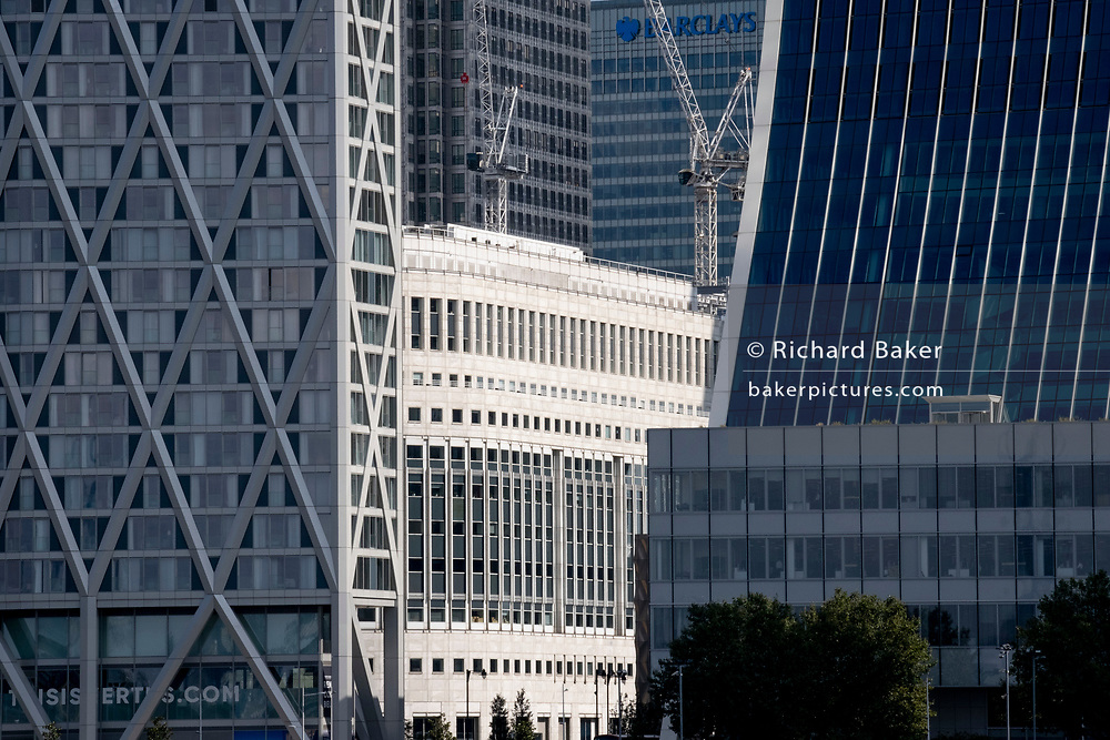 Corporate high-rise offices including the Barclays building at Canary Wharf in London Docklands, on 16th September 2021, in London, England. Canary Wharf was once a thriving Victorian cargo dock but after Thames shipping declined from the 1960s, its derelict areas were redeveloped in the 19080 by Margaret Thatcher's Docklands Development Corporation created one of the UK's main financial centres, now home to the European Headquarters of numerous major banks including Barclays, Credit Suisse and HSBC.