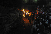 The lightning of the main fire at the Hillula (a celebration day) for Rabbi Simeon bar Yohai at Lag Baomer in Meron mountain, near Tzefat, the burial place of Rabbi Simeon bar Yochai and his son, Rabbi Eleazar ben Simon. hundred of thousands of people come each year to celebrate with lighting fires, candles, singing and feasting.  Photographed on May 2 2018