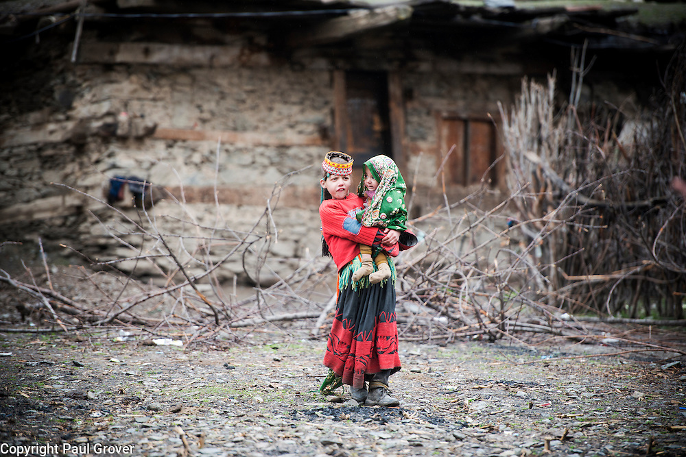 Bumburet, Chitral District,Pakistan.Pic Shows A Kalash girl and infant in the Kalash village in the valley of Bumburet