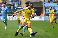 Bristol Rovers forward Johnson Clarke-Harris (19) battles for possession  with Coventry City defender (on loan from Chelsea) Dujon Sterling (17) during the EFL Sky Bet League 1 match between Coventry City and Bristol Rovers at the Ricoh Arena, Coventry, England on 7 April 2019.