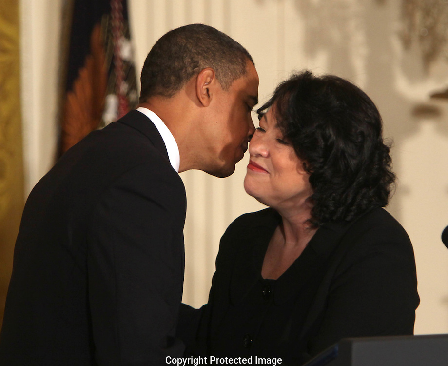 President Barack Obama and Supreme Court Justice  Sonia Sotomayor at a reception for Justice Sotomayor in the East Room of the White House on August 12, 2009.  Photograph by Dennis Brack