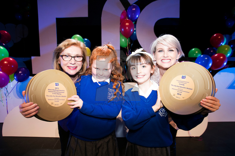 """Repro FRee: 03/11/2015 Jan O'Sullivan TD, Minister for Education and Skills is pictured with TV presenter Sinead Kennedy at the 11th FÍS Film Festival presenting Orla O'Hara and Lucy Robinson, students from Redeemer Girls NS, with the 'Aileen MacKeogh Overall Winners Award 2015' for their film """"The Jelly That Wouldn't Wobble"""", at a ceremony in the Helix, Dublin, 3 November. Picture Andres Poveda"""