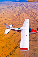 Two Desert Air Cessna 210's fly above the Namib Desert, Namibia
