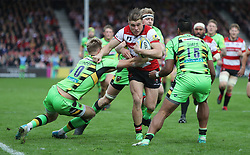 Gloucester's Jason Woodward is tackled by Northampton Saints Harry Mallinder during the Aviva Premiership match at the Kingsholm Stadium, Gloucester.