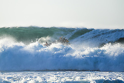 July 19, 2017 - The water safety boat got caught out of position by a very large wide set during the first heat of the day at the Corona Open J-Bay with the captain showing his experience and skills to avoid disaster at pumping Supertubes, Jeffreys Bay, South Africa...Corona Open J-Bay, Eastern Cape, South Africa - 19 Jul 2017. (Credit Image: © Rex Shutterstock via ZUMA Press)