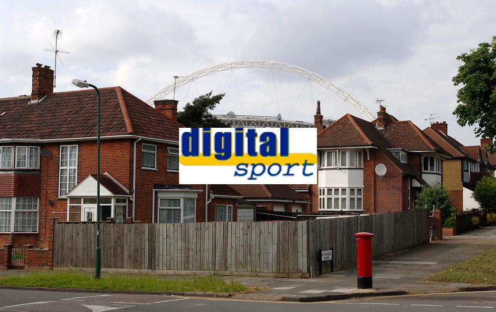 Photo: Daniel Hambury.<br /> Wembley Stadium. 14/06/2006.<br /> The new home of English football, Wembley, rises from the suburbs of north London.