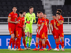 HELSINKI, FINLAND - Thursday, September 3, 2020: Wales players form a pre-match huddle before the UEFA Nations League Group Stage League B Group 4 match between Finland and Wales at the Helsingin Olympiastadion. Kieffer Moore, Dylan Levitt, goalkeeper Wayne Hennessey, Jonathan Williams. (Pic by Jussi Eskola/Propaganda)
