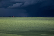 Ominous storm clouds approach Tonle Sap River, Cambodia