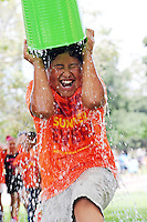 A summer camper douses himself during a water game at the Central Coast YMCA's annual Kids Day at Toro Park on Wednesday.