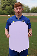 AFC Wimbledon midfielder Alfie Eagan (28) holding Fifa sign during the AFC Wimbledon 2018/19 official photocall at the Kings Sports Ground, New Malden, United Kingdom on 31 July 2018. Picture by Matthew Redman.