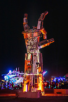I.L.Y (After the pyrotechnic display)<br /> by: Dan Mountain<br /> from: Portola Valley, CA<br /> year: 2019<br /> <br /> A 27 foot forearm and hand, fabricated from engineered steel, recycled and repurposed scrap metal meant to engage participants in various visual, physical, and emotional ways. Housing an internal armature of chains, gears, sprockets, and springs, the involvement of participants allows the fingers and parts of the hand to bring the sculpture to its full realization.<br /> <br /> The intention of ILY is to encourage communication, collaboration, and eagerness to work together.<br /> <br /> Contact: ilyproject2019@gmail.com