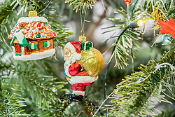 House and Santa Claus hanging on Christmas tree, Munich, Germany