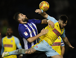 Sheffield Wednesday's Atdhe Nuhiu (left) battles for ball with Rotherham United's Richie Towell
