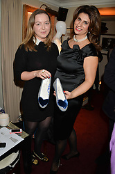 Left to right, ZENOUSKA MOWATT granddaughter of Princess Alexandra and CLAUDIA ARTHUR-FLATZ from the United National Office of Drugs and Crime at a party hosted by Lady Kinvara Balfour, Lavinia Brennan and Lady Natasha Rufus Isaacs to celebrate the Beulah French Sole Collaboration in aid of the UN Blue Heart Campaign, held at George, 87-88 Mount Street, London on 10th December 2013.