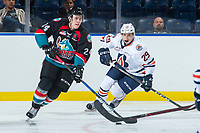 KELOWNA, CANADA - SEPTEMBER 5: Kyle Topping #24 of the Kelowna Rockets skates with the puck ahead of Justin Sigrist #29 of the Kamloops Blazers on September 5, 2017 at Prospera Place in Kelowna, British Columbia, Canada.  (Photo by Marissa Baecker/Shoot the Breeze)  *** Local Caption ***