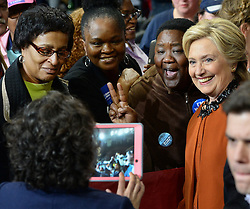 October 27, 2016 - Winston-Salem, NC, USA - Democratic presidential candidate Hillary Clinton poses with supporters after appearing with First Lady Michelle Obama at a campaign rally at Joel Coliseum in Winston-Salem, N.C., on Thursday, Oct. 27, 2016. (Credit Image: © Chuck Liddy/TNS via ZUMA Wire)