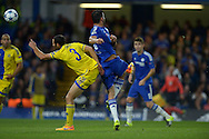 Diego Costa of Chelsea volleys to score his sides third goal of the match to make it 3-0. UEFA Champions League group G match, Chelsea v Maccabi Tel Aviv at Stamford Bridge in London on Wednesday 16th September 2015.<br /> pic by John Patrick Fletcher, Andrew Orchard sports photography.