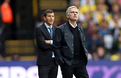 Manchester United manager Jose Mourinho (right) during the Premier League match at Vicarage Road, Watford