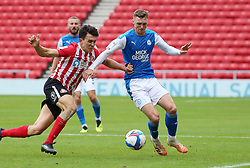 Jack Taylor of Peterborough United in action with Luke O'Nein of Sunderland - Mandatory by-line: Joe Dent/JMP - 26/09/2020 - FOOTBALL - Stadium of Light - Sunderland, England - Sunderland v Peterborough United - Sky Bet League One