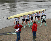 Putney, London,  Cambridge Goldie, carrying boat, after victory over Oxford Isis, 156th University Boat Race, River Thames, between Putney and Chiswick, on the Championship Course.  Saturday  03/04/2010 [Mandatory Credit Karon Phillips/Intersport Images]<br /> Cambridge Goldie Crew, Bow  - Wanne KROMDIJK, George LAMB, <br /> Mike THORP, Matt WHALEY, Hardy CUBASCH, Joel JENINGS, Moritz SCHRAMM, Stroke -  Geoff ROTH and Cox - Elizabeth BOX