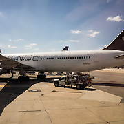 A Star Alliance plane parked at a gate at Dulles International Airport, a major hub for Star Alliance partner United Airlines.