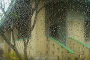 Rain on window outside the New Guinea Club, Rabaul, East New Britain, Papua New Guinea
