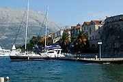 View of Korcula waterfront with Croatian mainland in background. Korcula old town, island of Korcula, Croatia..