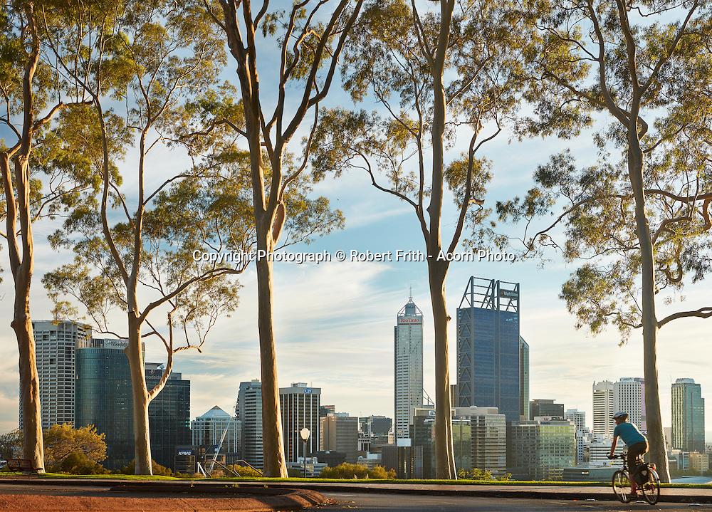 Cyclist at dawn with Perth city skyline Perth Region