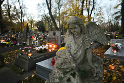 October 31, 2018 - Krakow, Poland - On the eve of All Saints' Day preparations get underway in Rakowicki Cemetery in Krakow. Ahead of the 1st November, All Saints Day, many people pay respects to dead family members, clean their family tombs, and many flowers and candles are placed on top of tombs. The 1st of November in Poland is a day off from work, and many people travel to visit the graves of their loved ones. (Credit Image: © Artur Widak/NurPhoto via ZUMA Press)