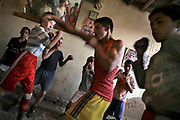 Afghan youths practices boxing in Akhteri Boxing Club in a Kabul's Khushal Khan area. Many young Afghan boys enjoy sports such as boxing, football, and bodybuilding in a country where source of entertainment is limited.