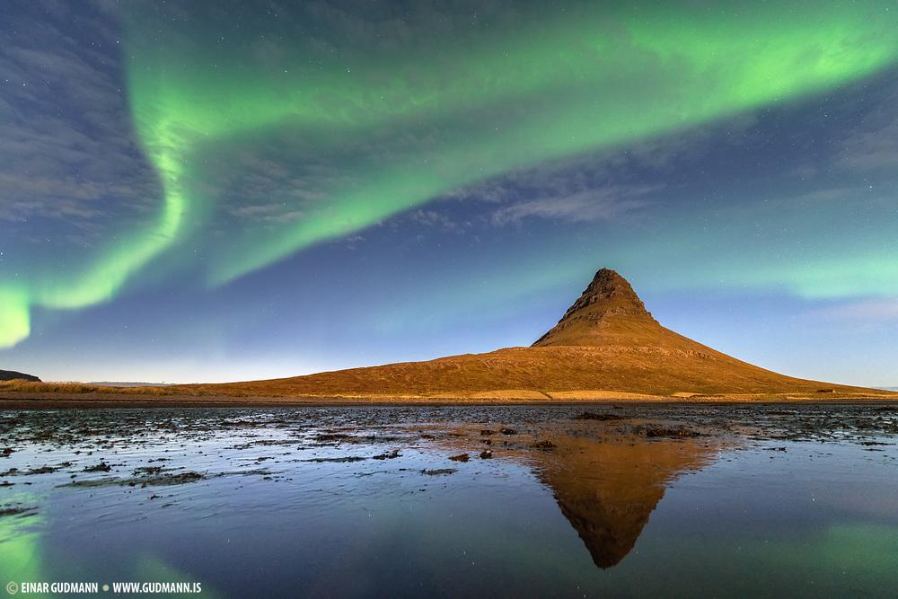 Northern lights (aurora) at the Kirkjufell mountain.