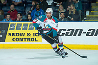 KELOWNA, CANADA - APRIL 8: Devante Stephens #21 of the Kelowna Rockets skates with the puck during second period on April 8, 2017 at Prospera Place in Kelowna, British Columbia, Canada.  (Photo by Marissa Baecker/Shoot the Breeze)  *** Local Caption ***