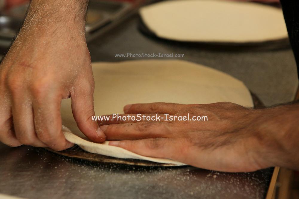 preparing the pizza base