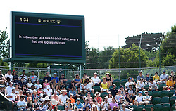 """A big screen reading """"In hot weather take care to drink water, wear a hat, and apply sunscreen"""" on court three on day six of the Wimbledon Championships at the All England Lawn Tennis and Croquet Club, Wimbledon."""