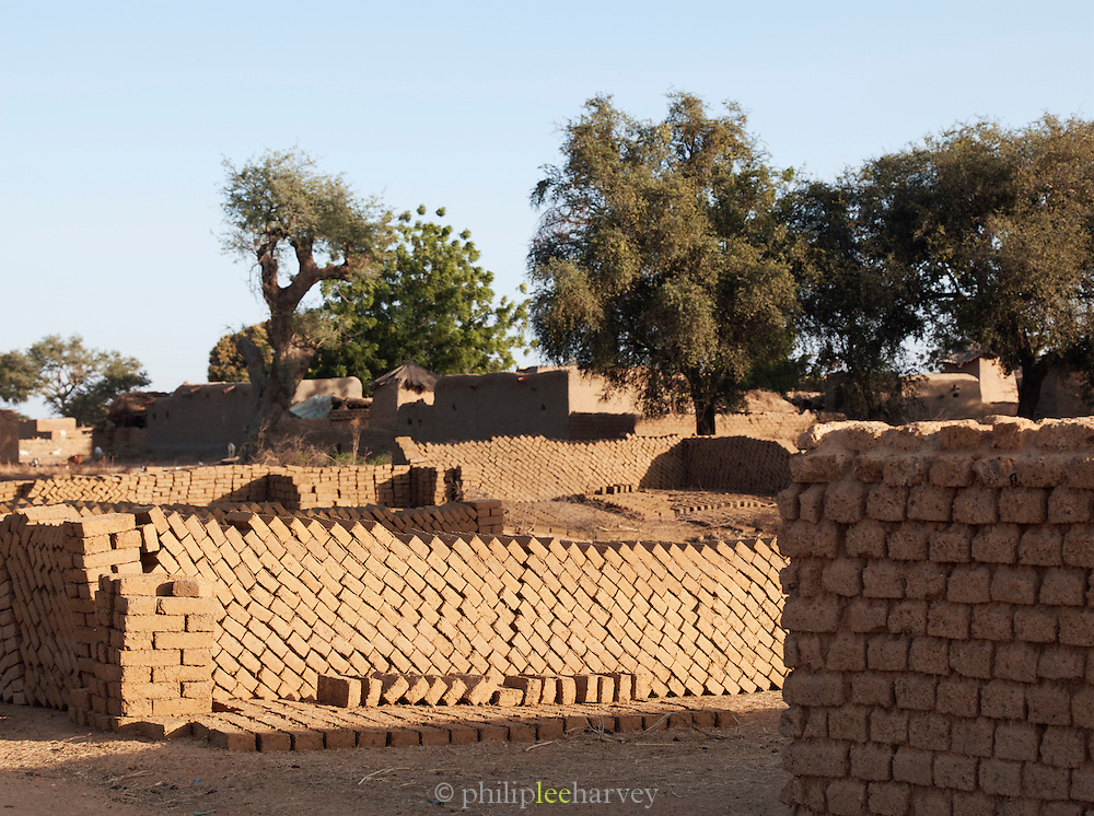 Freshly made bricks dry in the sun in a small, rural village near Djenné, Mali