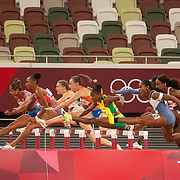 TOKYO, JAPAN August 1: Athletes pass empty seating in the 100m hurdles for women semi final during the Track and Field competition at the Olympic Stadium  at the Tokyo 2020 Summer Olympic Games on July 31, 2021 in Tokyo, Japan. (Photo by Tim Clayton/Corbis via Getty Images)